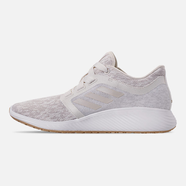 Left view of Women's adidas Edge Lux Running Shoes in Raw White/Cloud White/Gold Metallic