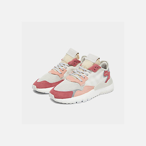 Three Quarter view of Women's adidas Originals Nite Jogger Casual Shoes in White/White/Pink