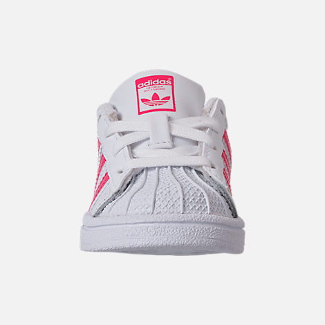 Front view of Girls' Toddler adidas Superstar Casual Shoes in White/Real Pink