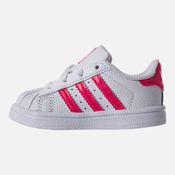 Left view of Girls' Toddler adidas Superstar Casual Shoes in White/Real Pink