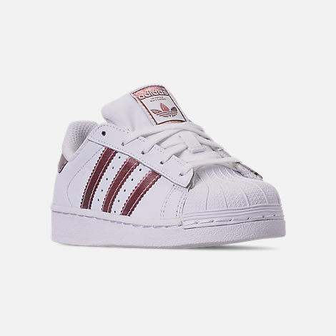 Three Quarter view of Girls' Little Kids' adidas Superstar Casual Shoes in White/Clear Orange