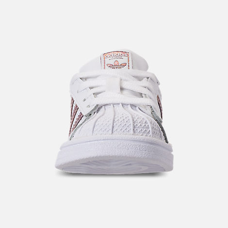 Front view of Girls' Toddler adidas Superstar Casual Shoes in White/Clear Orange