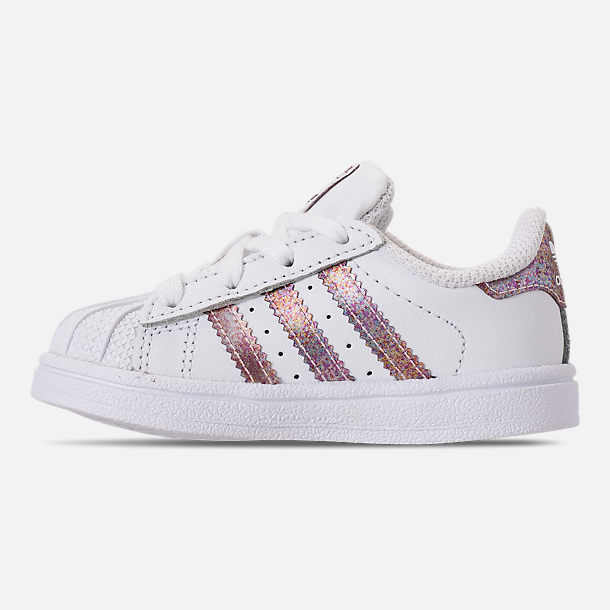 Left view of Girls' Toddler adidas Superstar Casual Shoes in White/Clear Orange