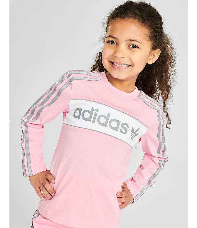 Front Three Quarter view of Girls' adidas Originals Solid Long-Sleeve T-Shirt in Light Pink