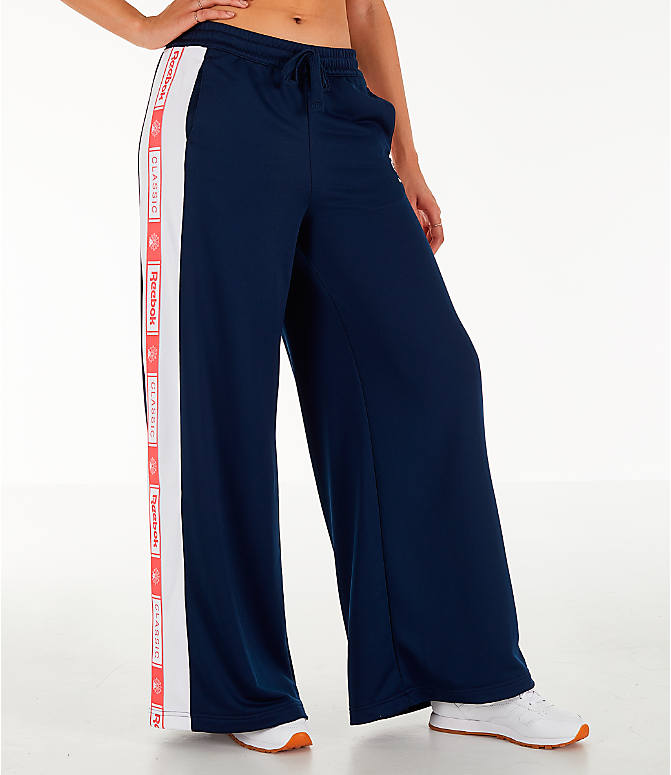 Front Three Quarter view of Women's Reebok Classics Wide Leg Track Pants in Collegiate Navy