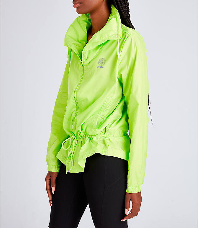 Front Three Quarter view of Women's Rebook Classics Graphic Windbreaker Jacket in Neon Lime