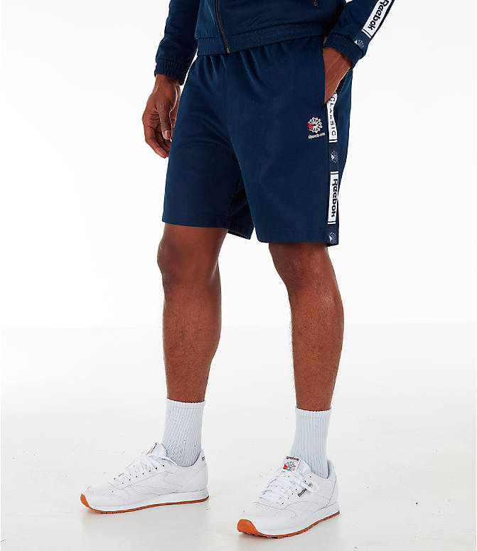 Front view of Men's Reebok Classics Taped Track Shorts in Collegiate Navy