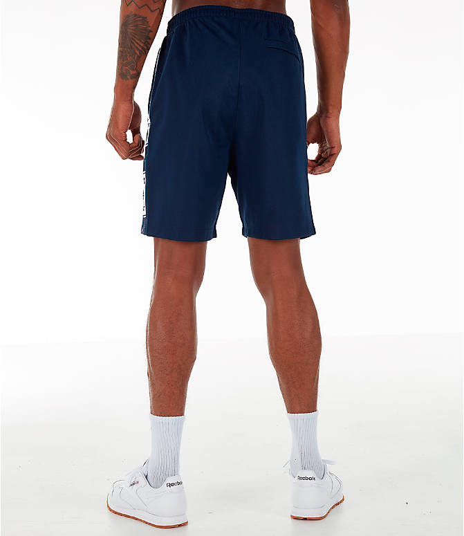 Back Left view of Men's Reebok Classics Taped Track Shorts in Collegiate Navy