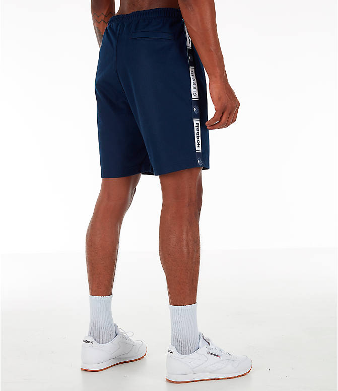 Back Right view of Men's Reebok Classics Taped Track Shorts in Collegiate Navy