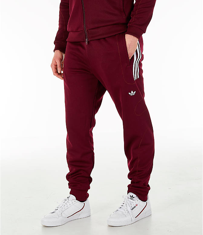 Front view of Men's adidas Originals Flamestrike Track Pants in Burgundy