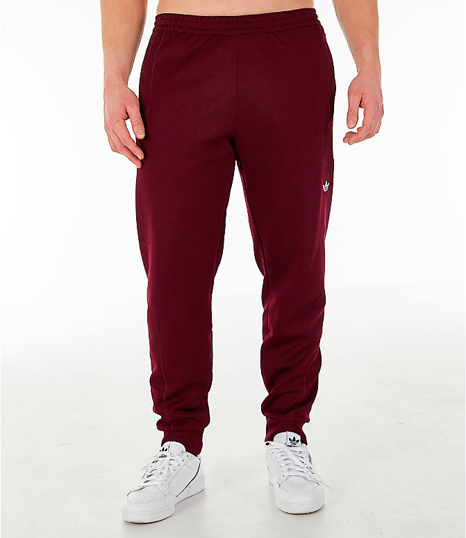 Front Three Quarter view of Men's adidas Originals Flamestrike Track Pants in Burgundy