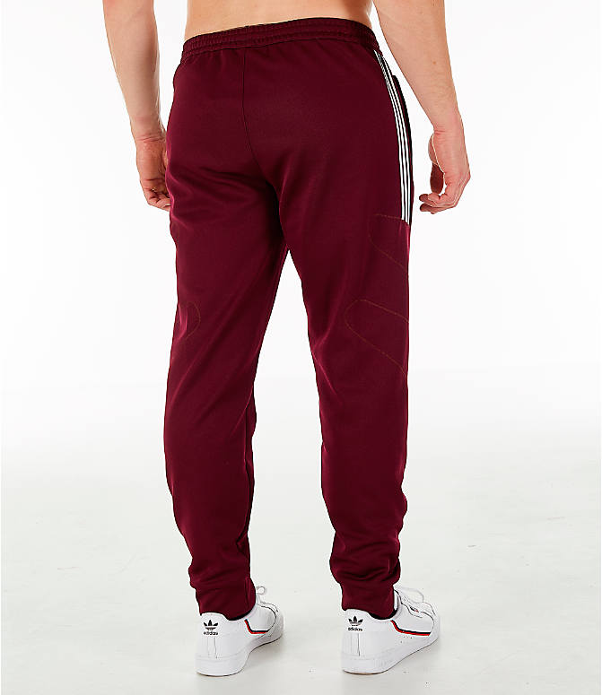 Back Right view of Men's adidas Originals Flamestrike Track Pants in Burgundy