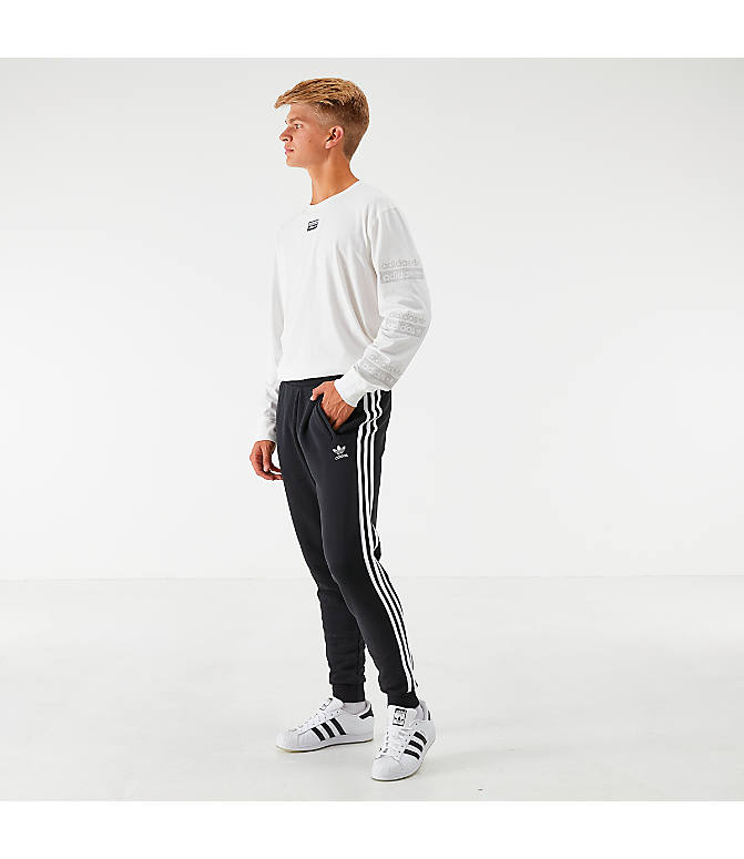 Front Three Quarter view of Men's adidas Originals 3-Stripe Pants in Black