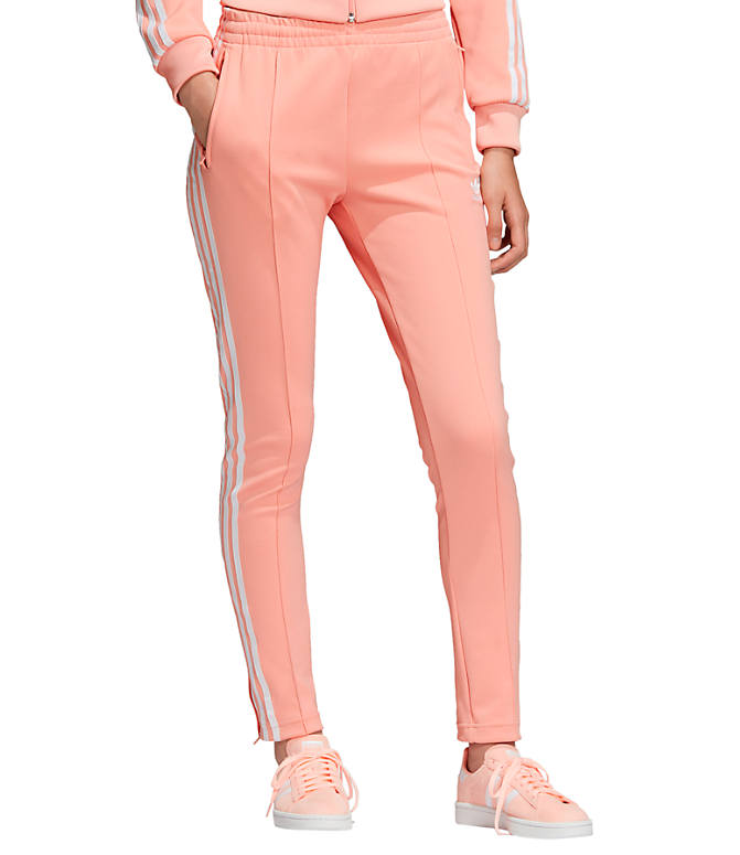 Front view of Women's adidas Originals Superstar Track Pants in Dust Pink