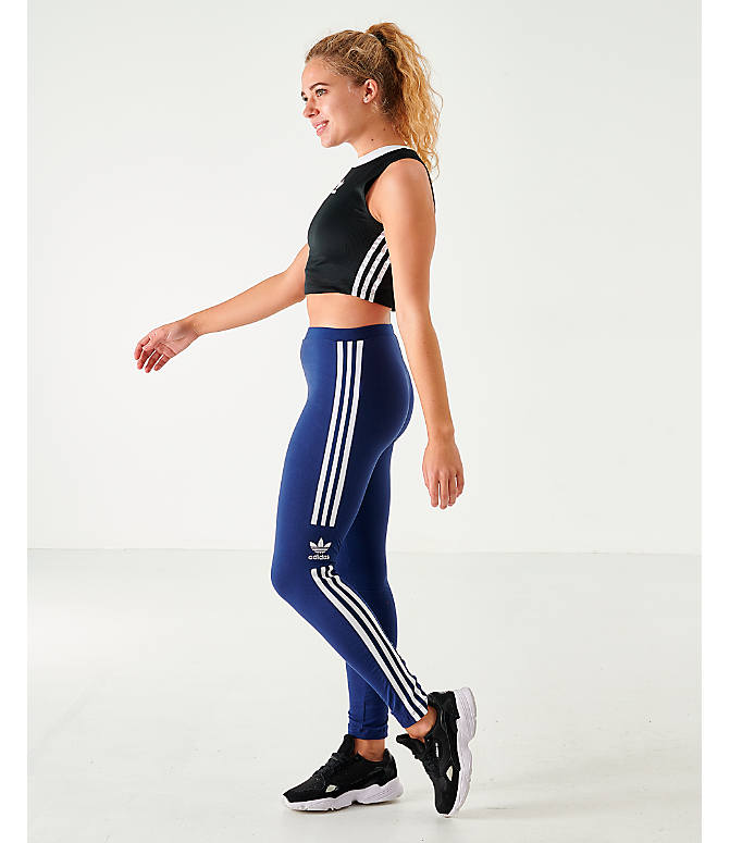 Front Three Quarter view of Women's adidas Originals Trefoil Leggings in Navy/White
