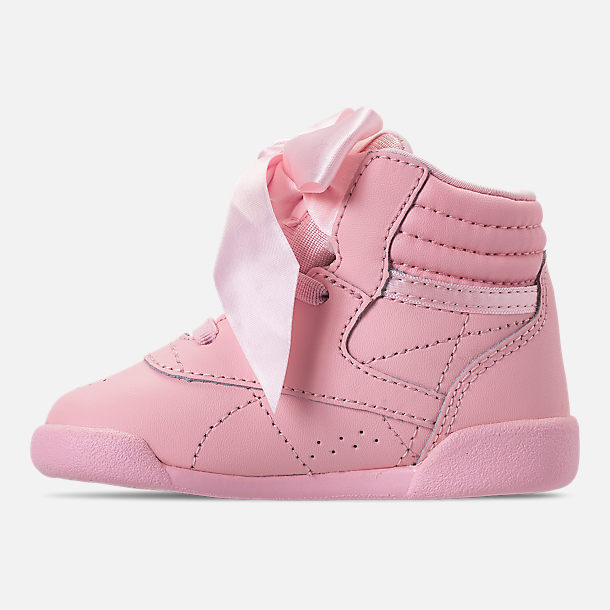 bbaa65237f1d8 Left view of Girls  Toddler Reebok Freestyle Hi Satin Bow Casual Shoes in  Saturated Luster