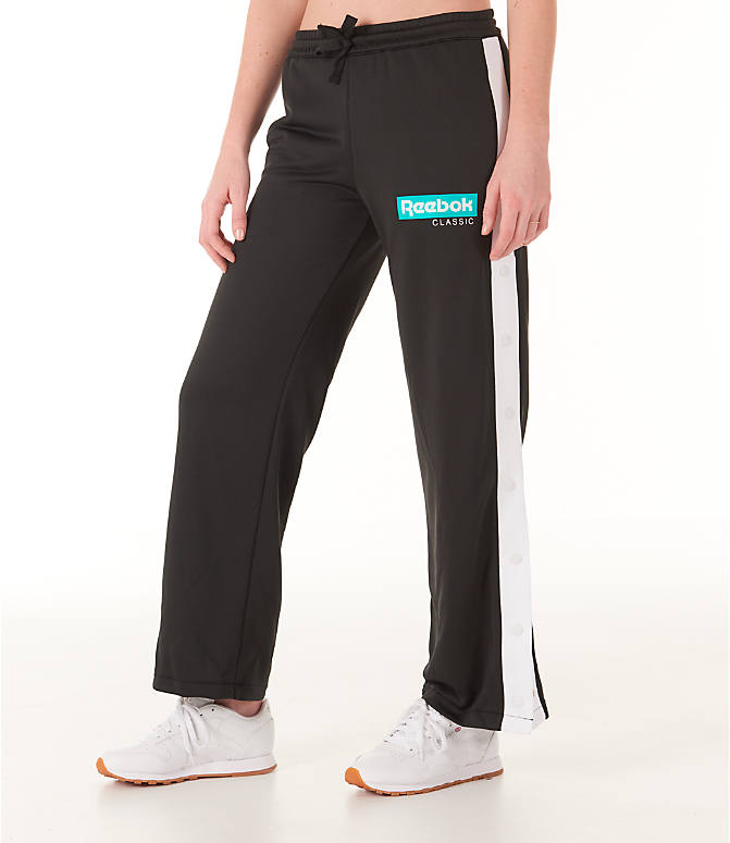 Front Three Quarter view of Women's Reebok Classics R Snap Track Pants in Black/White