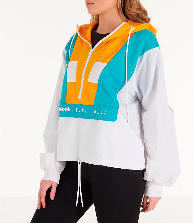 Front Three Quarter view of Women's Reebok x Gigi Hadid Classics Half-Zip Cover-Up Hoodie in White/Teal/Yellow