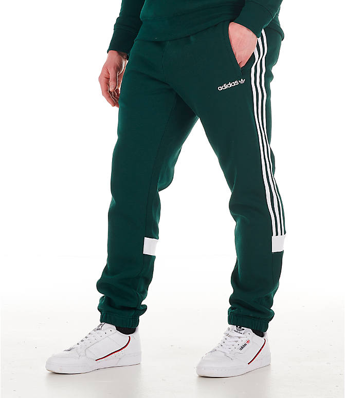 Front view of Men's adidas Originals Itasca Fleece Jogger Pants in Green Night