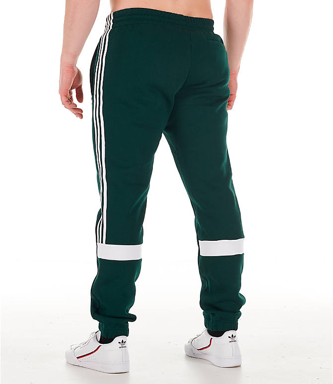 Back Left view of Men's adidas Originals Itasca Fleece Jogger Pants in Green Night