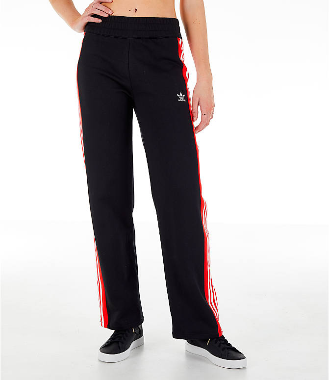 Front Three Quarter view of Women's adidas Originals Wide Leg Track Pants in Black/Red