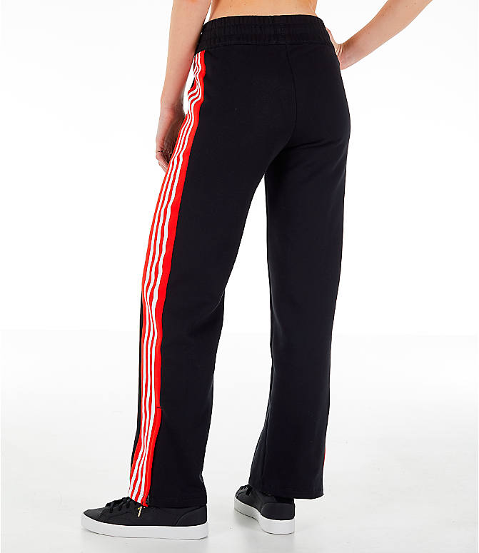 Back Left view of Women's adidas Originals Wide Leg Track Pants in Black/Red