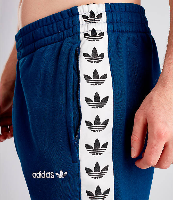 Detail 1 view of Men's adidas Originals Taped Fleece Pants in Mid Blue