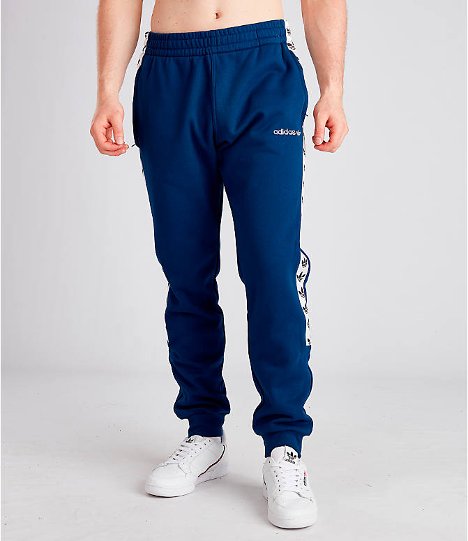 Front Three Quarter view of Men's adidas Originals Taped Fleece Pants in Mid Blue