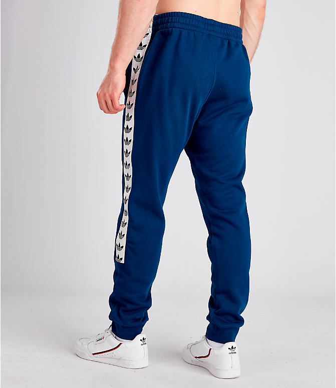 Back Left view of Men's adidas Originals Taped Fleece Pants in Mid Blue