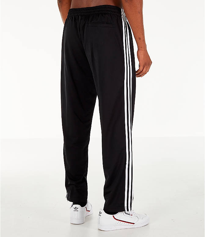 Back Right view of Men's adidas Originals Firebird Track Pants in Black