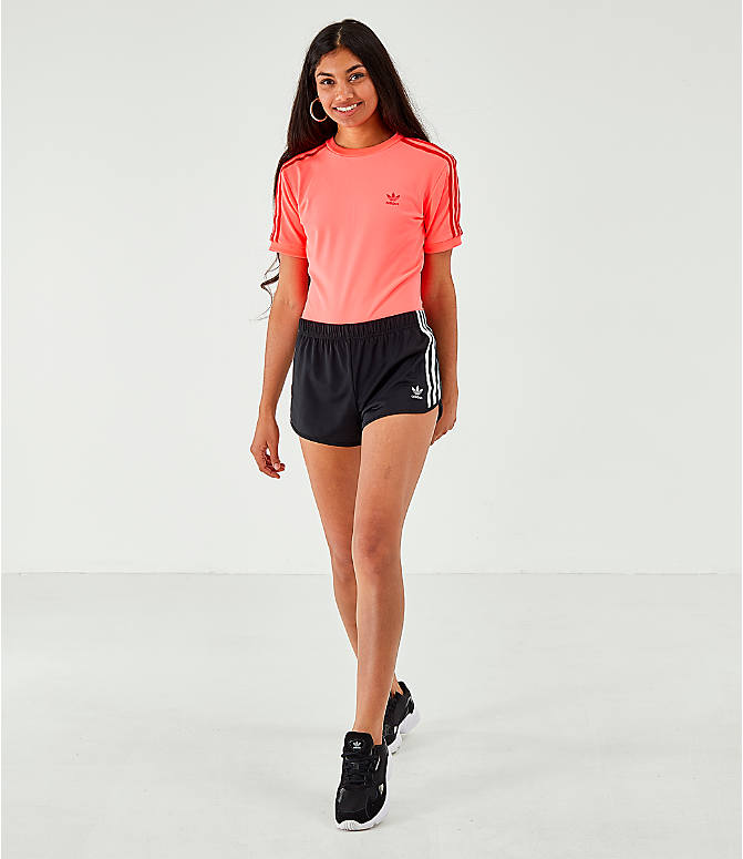 Front Three Quarter view of Women's adidas Originals Short-Sleeve Bodysuit in Red