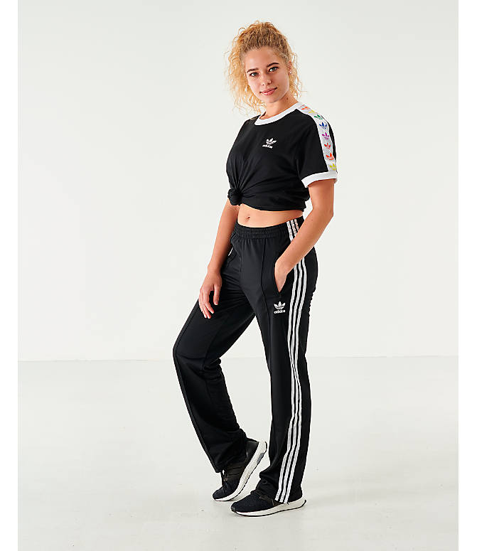Front Three Quarter view of Women's adidas Originals Firebird Track Pants in Black