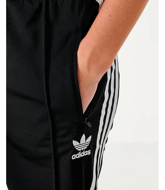 Back Right view of Women's adidas Originals Firebird Track Pants in Black