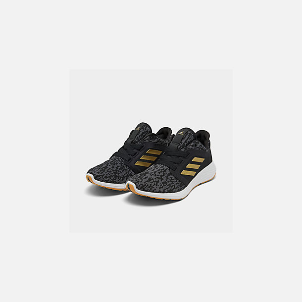 Three Quarter view of Women's adidas Edge Lux Running Shoes in Core Black/Gold Metallic/White