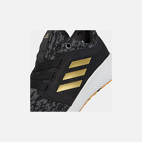 Front view of Women's adidas Edge Lux Running Shoes in Core Black/Gold Metallic/White