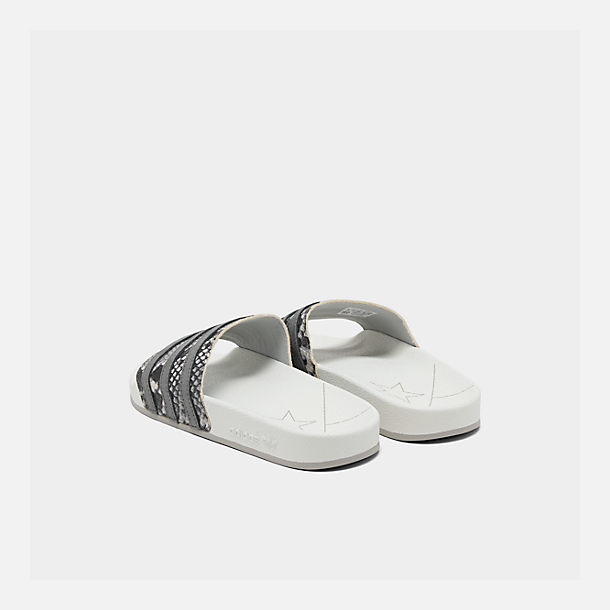 Left view of Men's adidas Adilette Slide Sandals in Crystal White/Grey Four/Grey Two