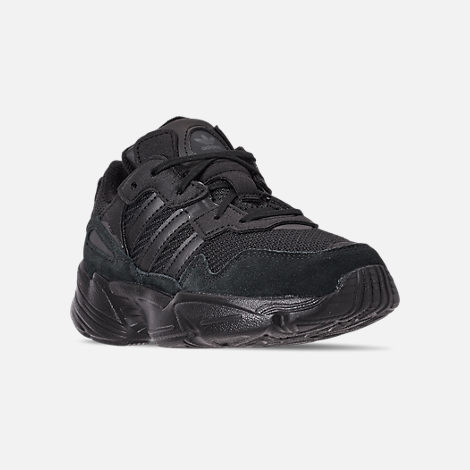 Three Quarter view of Boys' Little Kids' adidas Originals Yung-96 Basketball Shoes in Core Black/Core Black/Carbon