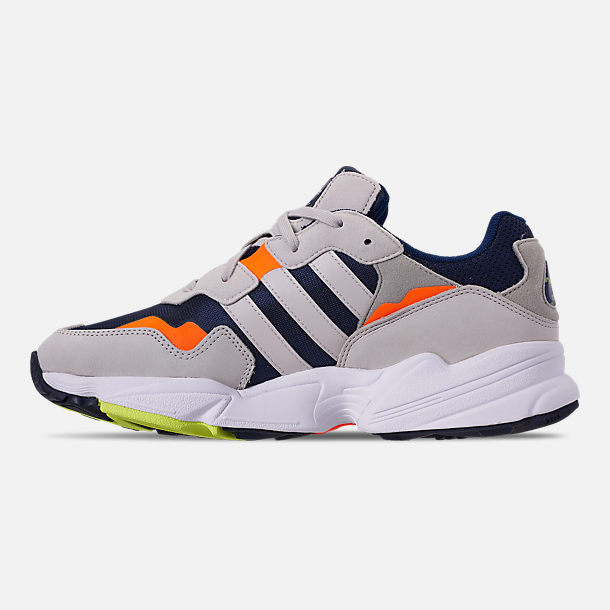 Left view of Men's adidas Originals Yung-96 Casual Shoes in Collegiate Navy/Raw White/Solar Orange