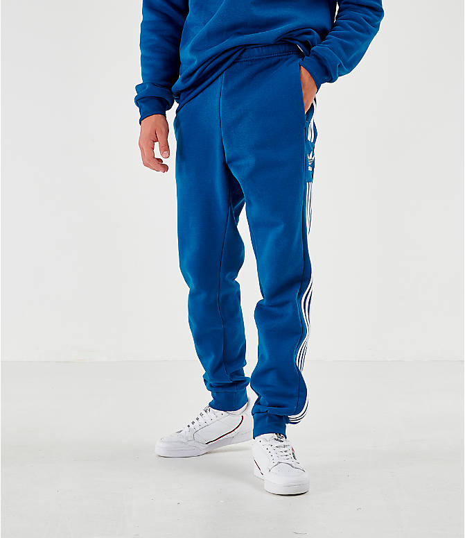 Front view of Men's adidas Originals ID96 Track Pants in Blue