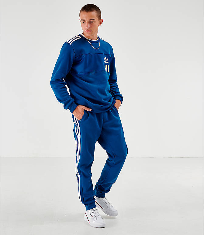Front Three Quarter view of Men's adidas Originals ID96 Track Pants in Blue
