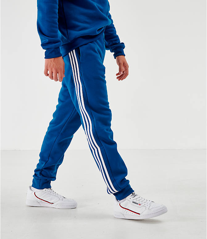 Back Left view of Men's adidas Originals ID96 Track Pants in Blue