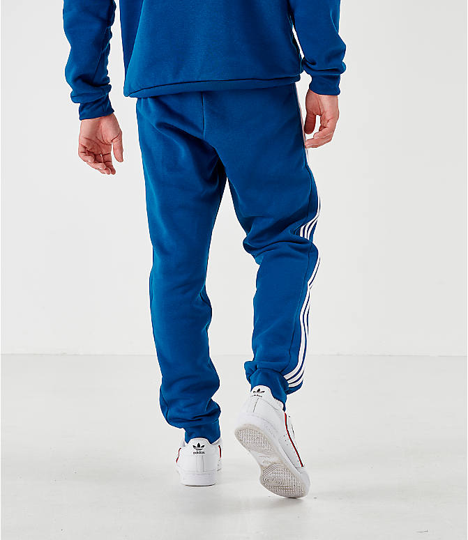 Back Right view of Men's adidas Originals ID96 Track Pants in Blue