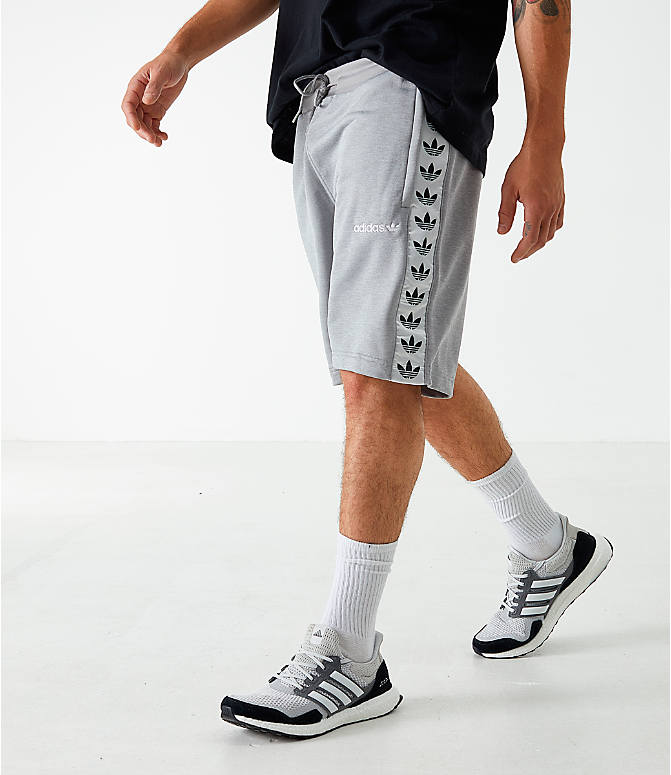 Front Three Quarter view of Men's adidas Originals Poly Tape Shorts in Grey
