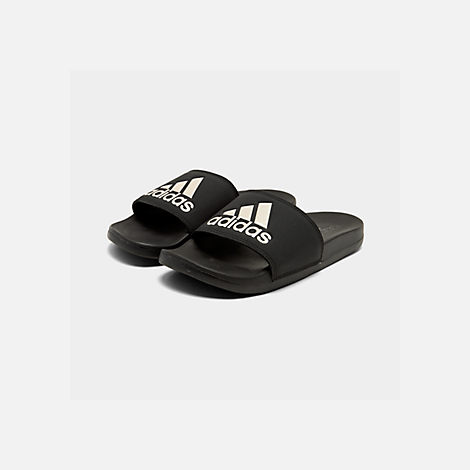 70de037ed17a Three Quarter view of Women s adidas Adilette Slide Sandals in Core Black Grey  Metallic