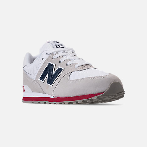 Three Quarter view of Boys' Grade School New Balance 574 Suede Casual Shoes in Nimbus Cloud/Navy
