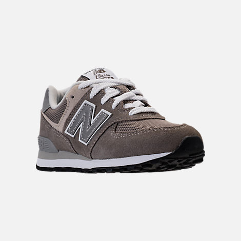 Three Quarter view of Boys' Grade School New Balance 574 Core Casual Shoes in Grey/Grey