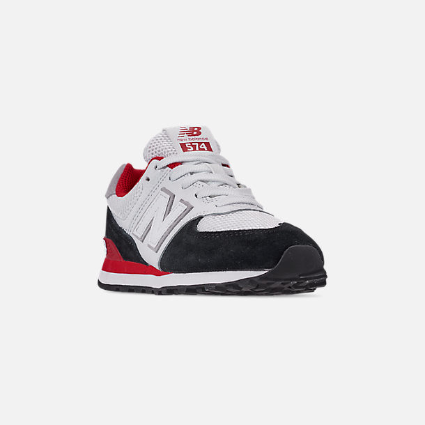 Three Quarter view of Boys' Big Kids' New Balance 574 Casual Shoes in Black/Team Red
