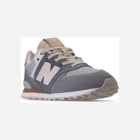 Three Quarter view of Girls' Grade School New Balance 574 Casual Shoes in Gunmetal/Steel