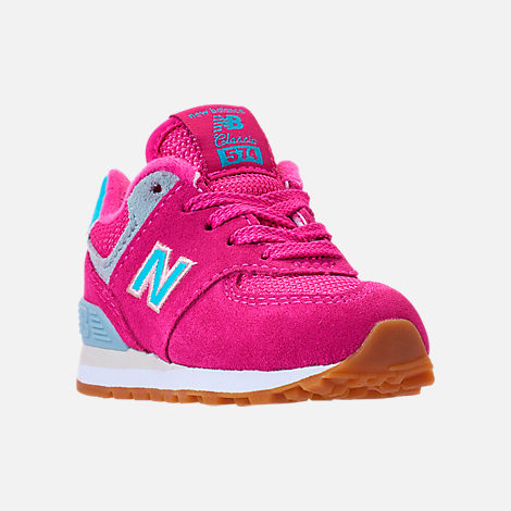 Three Quarter view of Girls' Toddler New Balance 574 Casual Shoes in Exuberant Pink/Blue