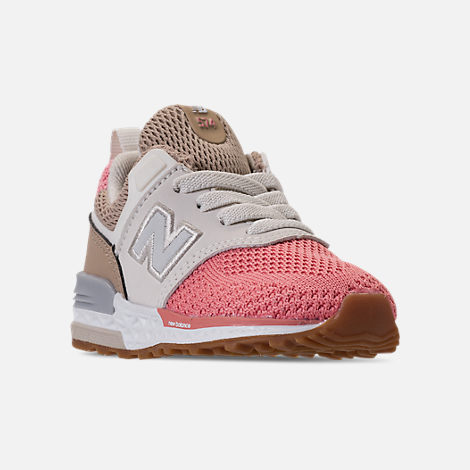 Three Quarter view of Girls' Toddler New Balance 574 Sport Casual Shoes in Hemp/Dusted Peach